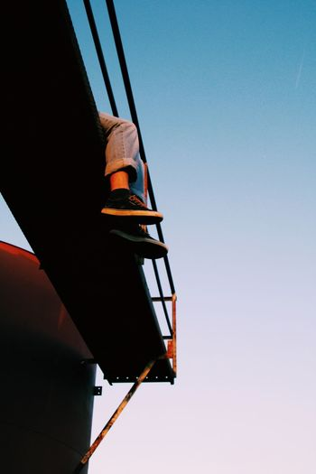 Low angle view of boat against clear sky