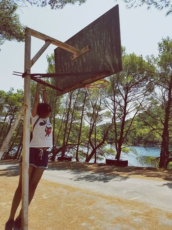 Leisure Activity One Young Woman Only People Tree Sport Outdoors Day Sky Nature Beauty In Nature Sea Sea And Sky Sea Side Island Islandsofadventures Backtochildhood Memories Mickey Mouse Basketball Basketball Court