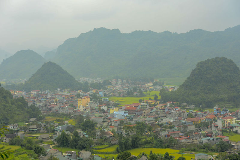 Beautiful View of Quan Ba town in Ha Giang district during cloudy and foggy morning. Witness of the twin mountain . The road is the gateway to the Dong Van Karst Plateau Geopark Quản Bạ World Heritage Site By UNESCO Unesco Landscape Geopark Town Paddy Fields Mountain Architecture Tree Built Structure Building Building Exterior Plant Nature Scenics - Nature Fog Beauty In Nature Environment Day Sky No People House Residential District High Angle View Mountain Range Outdoors TOWNSCAPE