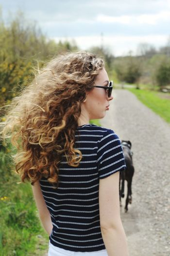 going for a walk Greyhound Walking Countryside Park EyeEm Selects Young Women Curly Hair Road Rural Scene Summer Long Hair Sunglasses Sky Casual Clothing Whisker Pet Collar Domestic Animals Dog