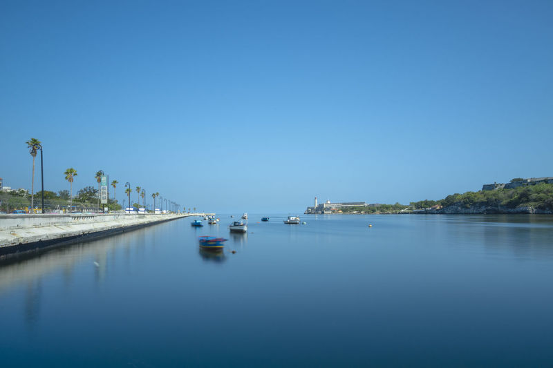Blue Havana Havana, Cuba Scenic Panoramic Havana Apparel Marine Marine Life Long Exposure Blue Blue Sky Clear Sky Calm Water Clear Sky Nautical Vessel Sea Yacht Blue Yachting Reflection Sailboat Moored Marina Port Harbor Water Vehicle Motorboat Boat Standing Water