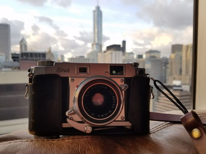 Shooting film with my 1950s-era Ricoh rangefinder. Retro Styled Old-fashioned Cloud - Sky No People Technology Indoors  Arts Culture And Entertainment Photography Themes City Skyscraper Camera - Photographic Equipment Architecture Building Exterior Sky Day Urban Skyline Cityscape Close-up Chicago Skyline Ricoh Low Angle View Leather 35mm Film