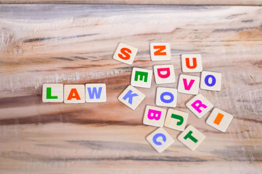 LAW WRITTEN ON WOODEN TABLE WITH BLOCK LETTERS Wood - Material Toy Block Letter Toy Multi Colored Alphabet Beach Number Still Life Communication Land Capital Letter Law Law School Justice - Concept Lawyer Block Letters Judge - Law Judgement Lawsuit Educational Law Conceptual Wooden