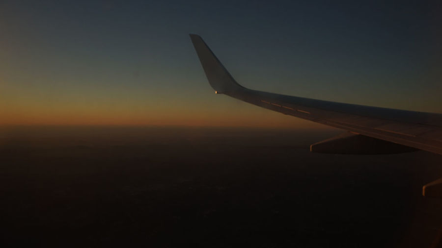 Airplane wing against clear sky