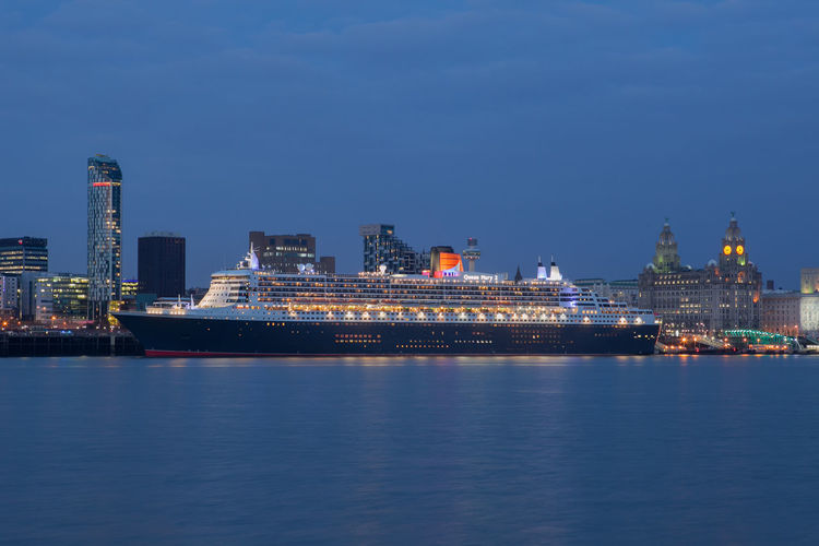 Cunard's Queen Mary 2 on the River Mersey, Liverpool Architecture Boat City Cityscape Cruise Ship Cunard Illuminated Liverpool Mersey Merseyside Night Photography Nightphotography QM2 Queen Mary 2 Queen Mary II River Royal Liver Building Ship Skyline Travel Destinations Urban Skyline Waterfront