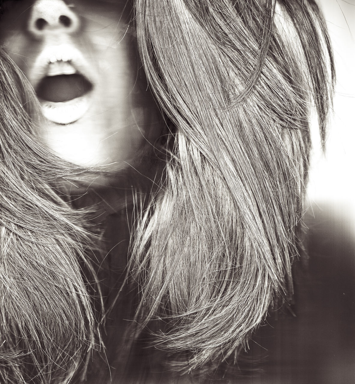 Close-Up Of Shocked Woman With Mouth Open