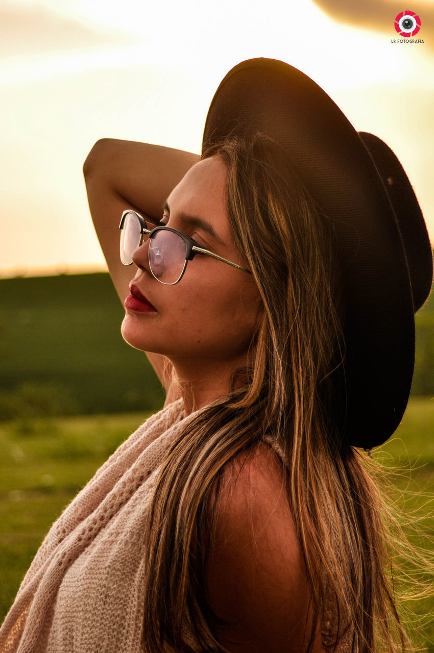 one person, real people, leisure activity, headshot, lifestyles, glasses, portrait, young adult, focus on foreground, young women, adult, women, hairstyle, hair, sunglasses, looking, day, eyeglasses, fashion, outdoors, beautiful woman, teenager