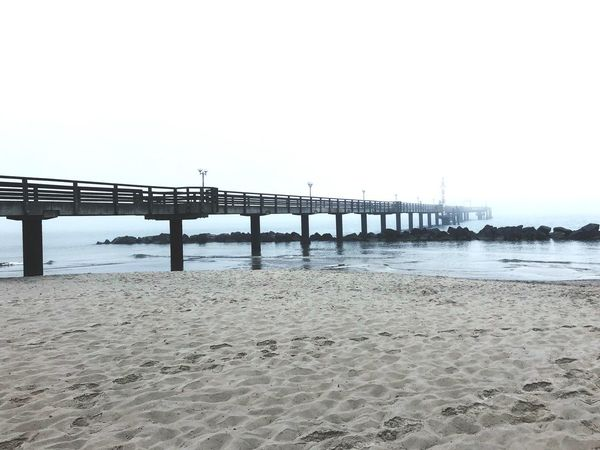 Foggy Water Sky Beach Sea Land Nature Sand Bridge Tranquility Scenics - Nature Day Built Structure No People