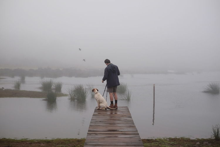 Misty morning missions in the Misty Hills of Nyanga, Zimbabwe. Africa Cold Dam Jetty Lake Lifestyles Man And Dog Men Mist Misty Morning Nature Nature Person Pet Photographer Pier Pier Scenics Tranquil Scene Tranquility Water Young Adult Young Men