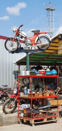 Stack of bicycle on metal against sky