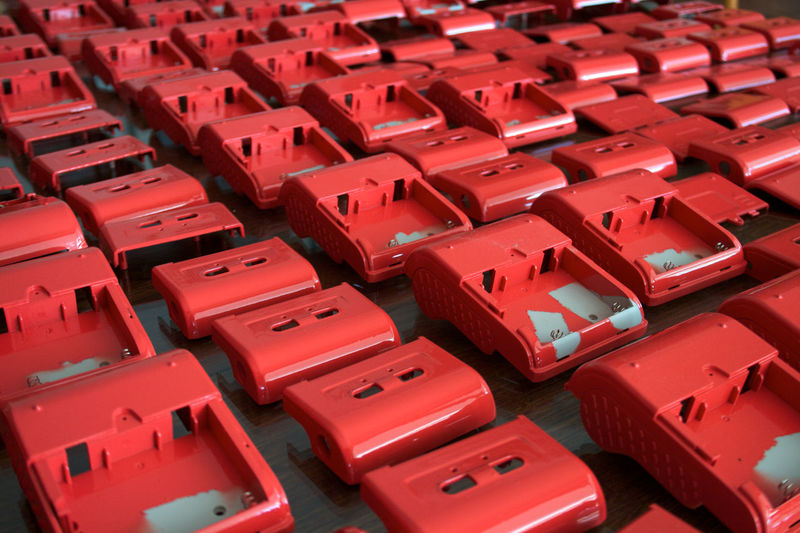 Full frame shot of red plastic electrical equipment at factory