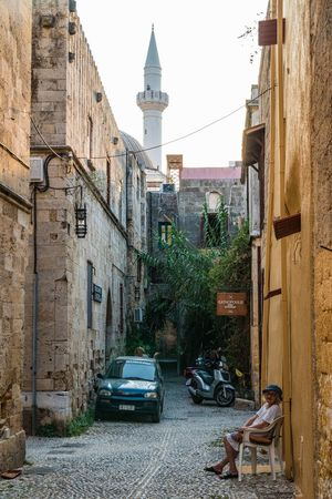 #Mosque #alley #minaret #old Woman #sitting Woman #tower #photography Architecture Building Exterior Built Structure Day Outdoors