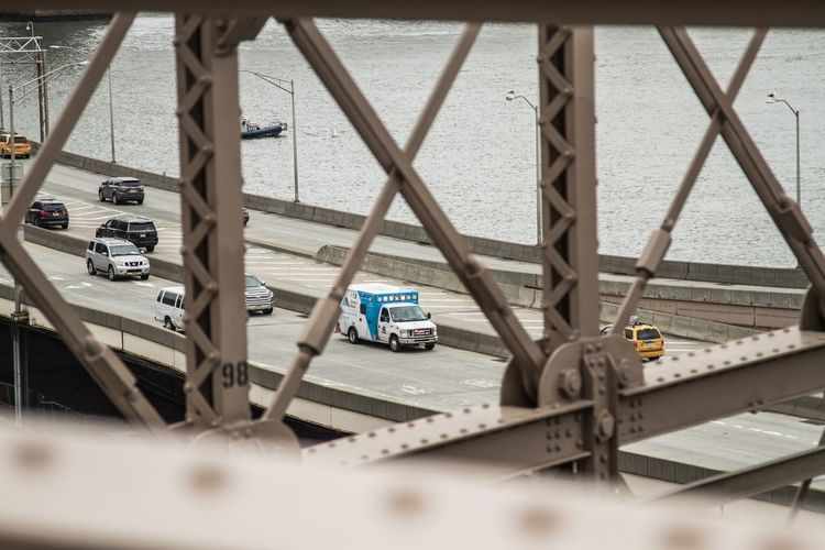 Ambulance driving next to Brooklyn Bridge Looking Through Driving Responding Moving Travel Road Highway Manhattan New York City Yellow Taxi Boat Colour Looking Down Blue Lights  Water River Brooklyn Bridge / New York Bridge - Man Made Structure Bridge Cars Ambulance Lights Ambulance Service Ambulance Emergency Vehicle Emergency Focus On Background Transportation Day No People Outdoors