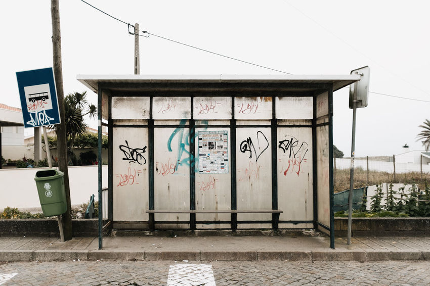 LOST IN GALICIA 🚌 Lostingalicia Threeweeksgalicia Bus Stop Graffiti Architecture Built Structure Building Exterior Creativity Day No People Text Art And Craft Communication Sky Building Outdoors Human Representation Entrance Nature Representation Wall - Building Feature Clear Sky