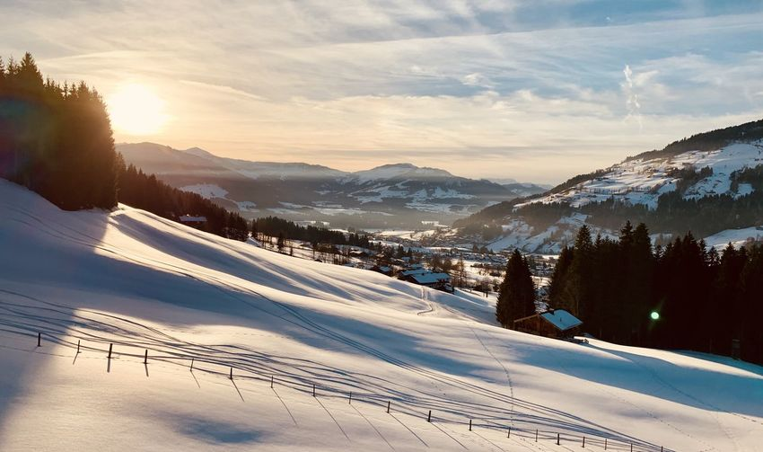 Scenic view of snow covered mountains against sky at austria wilder kaiser