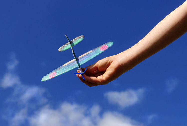 Model Aeroplane Aeroplane Blue Child Close-up Clouds Glider Holding Model Outdoors Person Sky