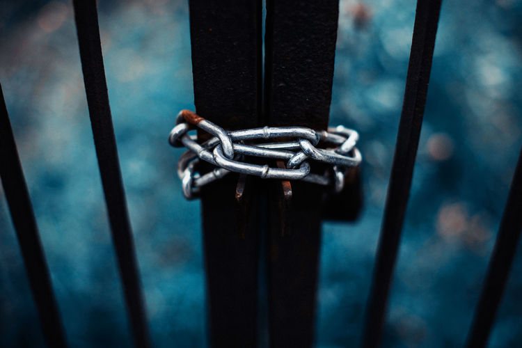 Close-up of gate locked with chain
