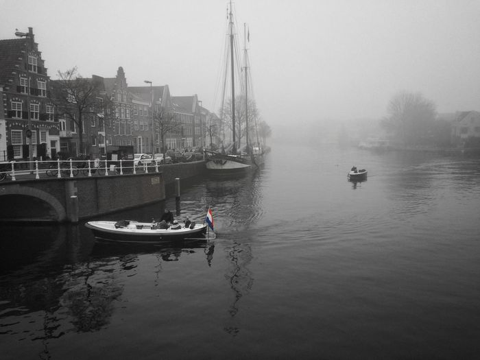 Haarlem Misty Canal First Eyeem Photo IPhoneography Waterfront Water Sky River Reflection Cityscape Built Structure Building Exterior Atmosphere Architecture The Tourist Old-fashioned Focus On Foreground Leisure Activity Water Reflections
