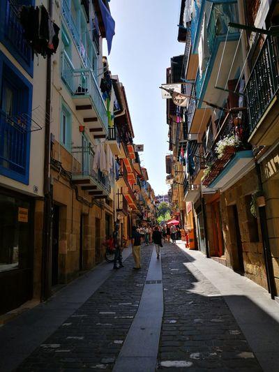People walking on street in city