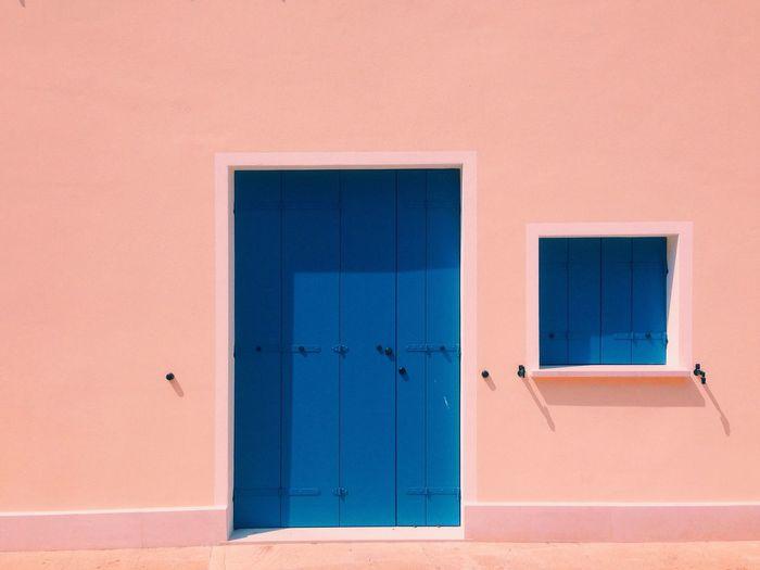 Blue door and window of house