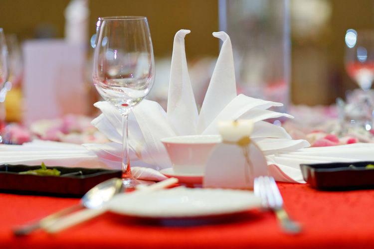 Restaurant table setting Table Wineglass Plate Glass Selective Focus Setting Place Setting Restaurant Household Equipment Drinking Glass Food And Drink Eating Utensil No People Napkin Business Red Kitchen Utensil Food Still Life Dining Table Crockery Table Knife Luxury