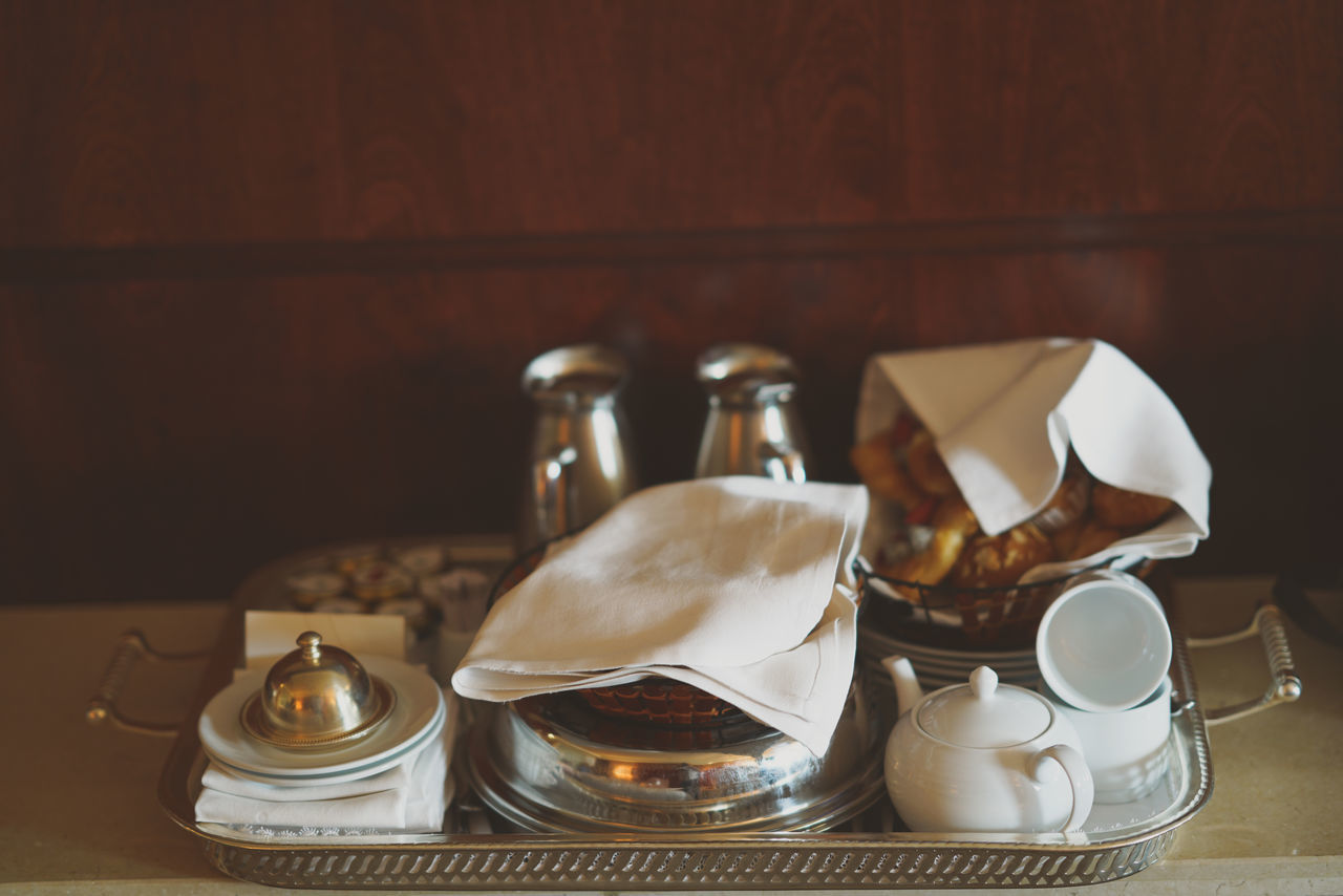 Close-Up Of Food And Crockery In Tray On Table
