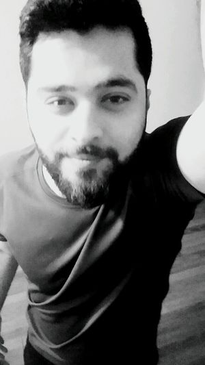calm down it was me Blackandwhite Beauty In Nature Smiling Man Headshot Rate Me After Weight Training Portrait Looking At Camera Men Beard Human Face Close-up Gangster Mafia  Biting Lip Film Noir Style Nose Ring