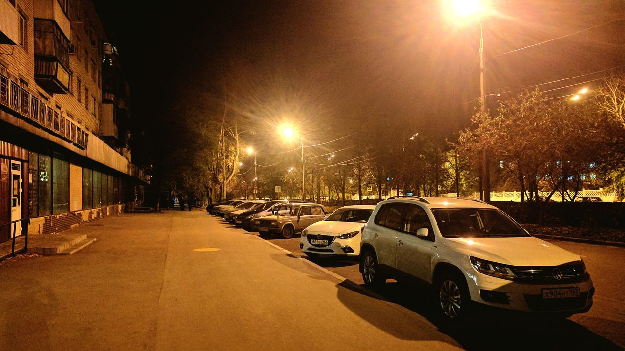 car, illuminated, transportation, land vehicle, mode of transport, night, building exterior, street light, outdoors, no people, road, built structure, architecture, city, sky
