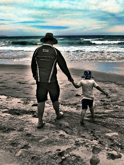Spending g time with my boys is what I love doing most. we have so much fun 👪 My Life My View My Year My View Sea Rear View Togetherness People Real People Vacations Full Length Sand Leisure Activity Water Father And Son Black And White With A Splash Of Colour Two People Big And Small Beachphotography Water_collection Sand & Sea