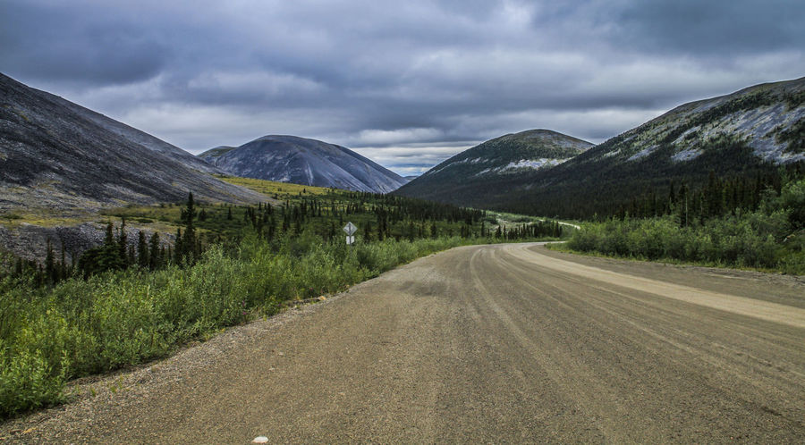 Dempster Highway Alaska Beauty In Nature Cloud - Sky Day Gravel Road Landscape Mountain Nature No People Outdoors Road Scenics Sky The Way Forward Tranquil Scene Tranquility Transportation