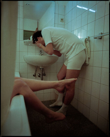 Side view of a man in bathroom
