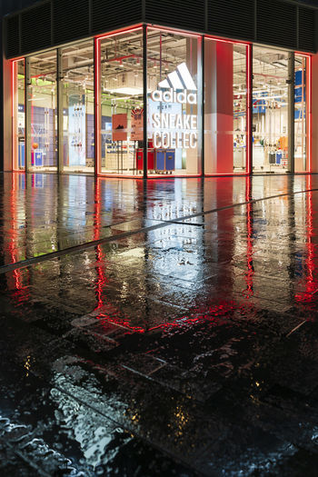 Reflection of building on wet glass during rainy season