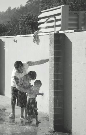 ~father and sons enjoying in public shower at beach! Eyeemphoto EyeEm Best Shots Showcase June EyeEm Best Shots - Black + White Streetphotography Father And Son California Summer Shower Time Innocenceofachild Childhood Life Is A Beach Beach Photography Fatherhood Moments The Street Photographer - 2017 EyeEm Awards