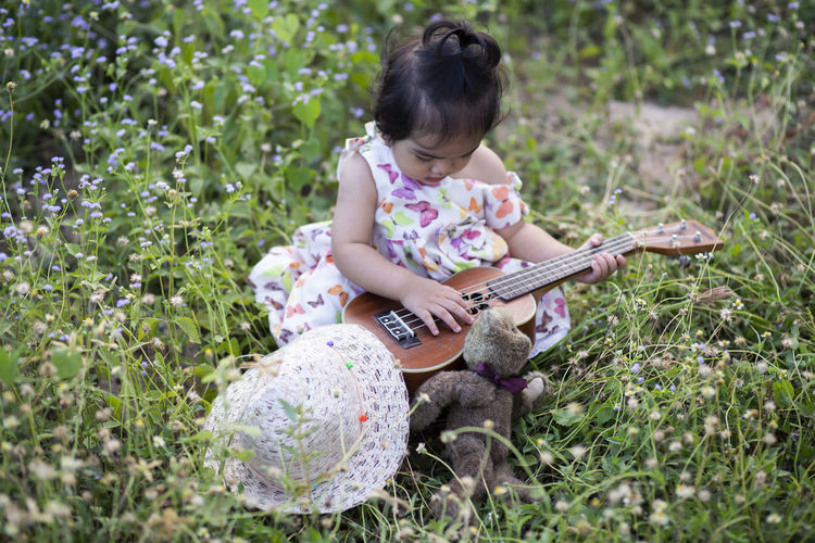 Full length of girl playing on field