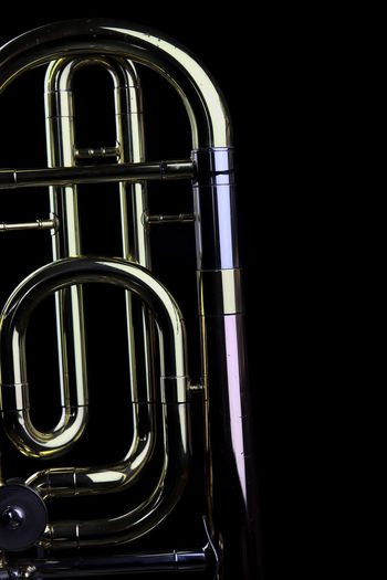 Music Instrument Trombone Metal No People Black Background Indoors  Brass Instrument  Studio Shot Musical Instrument Close-up Music Brass Arts Culture And Entertainment Curve Steel Wind Instrument Copy Space Dark Shiny Cut Out Night Alloy Silver Colored