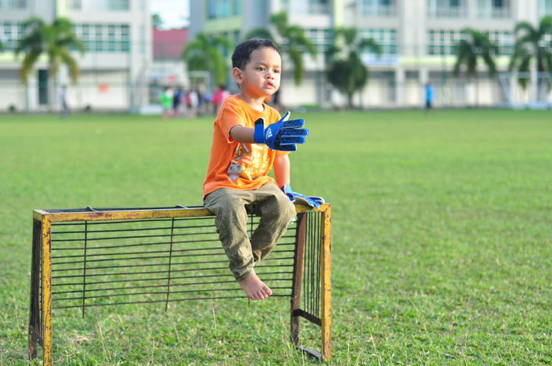 One Person Child Childhood Sport Children Only Full Length Grass People Outdoors Soccer Competition Day Playing Sports Clothing Healthy Lifestyle Sports Uniform Soccer Field EyeEm Selects Malaysia Sarawak EyeEm Gallery EyeEmBestPics EyeEm Best Shots EyeEmNewHere Taking Photos