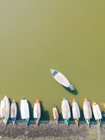 Row of boat docking beside the lake