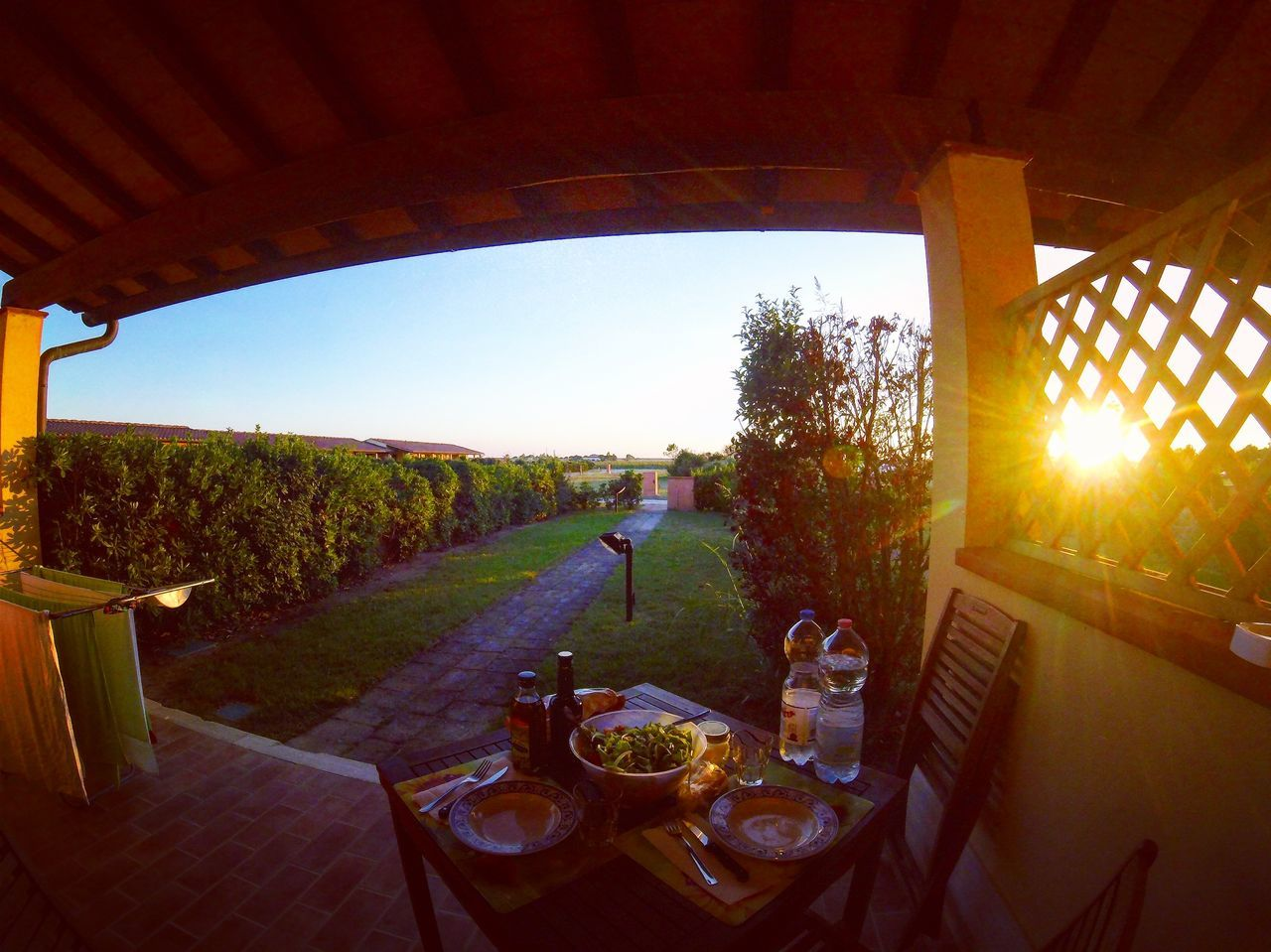table, food and drink, no people, sun, food, landscape, sunlight, outdoors, sky, nature, sunset, grass, clear sky, tree, day, freshness