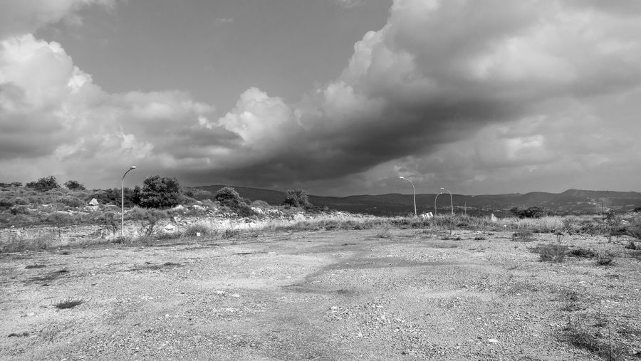 Environment Sky Cloud - Sky Landscape Land Day No People Field Fuel And Power Generation Nature Beauty In Nature Tranquility Non-urban Scene Tranquil Scene Scenics - Nature Outdoors Mountain Grass Remote Power In Nature Arid Climate Pollution Blackandwhite Black And White EyeEm