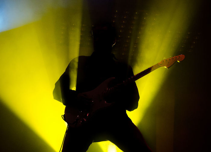 Low angle view of silhouette guitarist