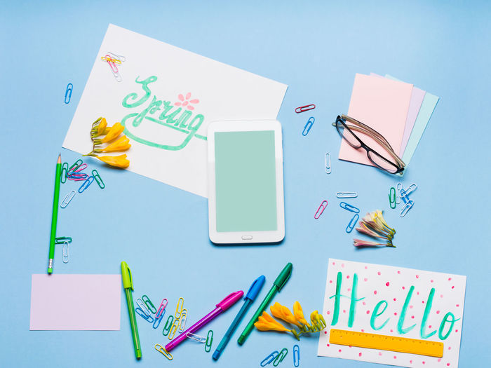High angle view of multi colored stationaries on table