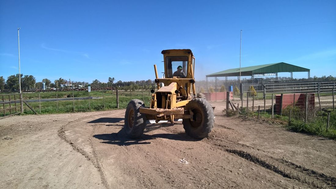 A heavy machine working on a rural road Agriculture Argentina Cattle Farm Country Country Road Farm Feed Lot Feedlots Man Working Rural Roads Rural Scene Transportation