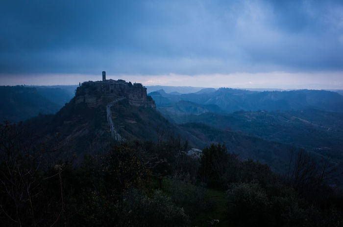 Landscape with the old village of Civita di Bagnoregio at dusk in a cloudy day. Ancient Cloudy Italia Bagnoregio Beauty In Nature Civita Di Bagnoregio Cloud - Sky Clouds Day Dusk Italy Landscape Lazio Mountain Nature No People Old Outdoors Scenics Sky Tranquil Scene Tranquility Tuscia  Village