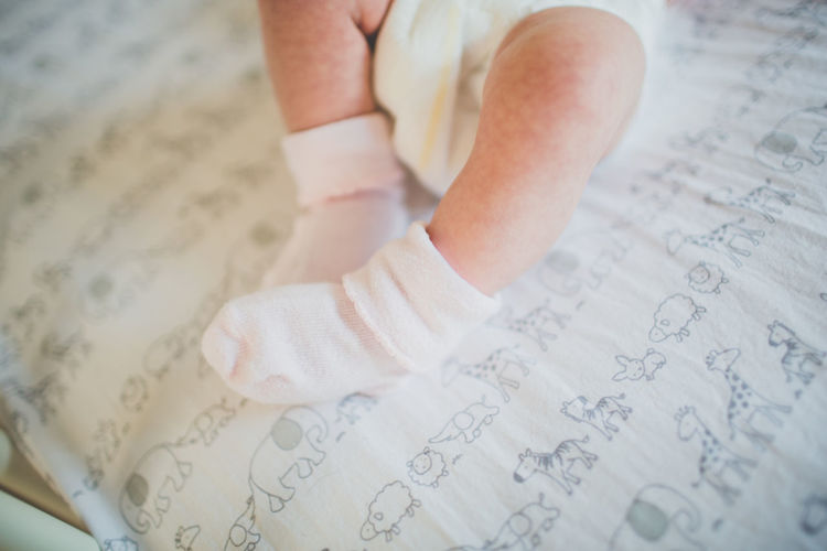 Newborn Baby in Crib Baby Lifestyle Motherhood Nursery Childhood Close-up Crib Cute Day Feet Indoors  Infant Laying In Bed Legs Little One Person People Real Life Real People Reality Sleeping Softness Sweet Top Perspective Top View