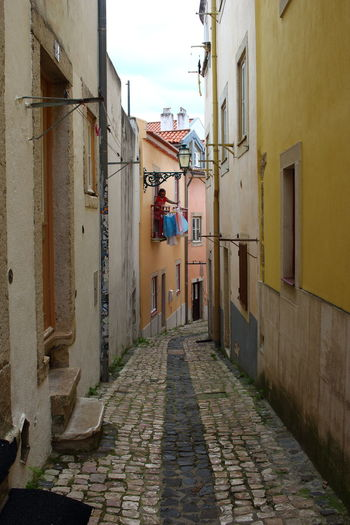 Streets Of Lisbon EyeEm City Lover Lissabon, Portugal Lisboa Portugal Lisbon - Portugal Building Exterior Architecture Built Structure Building The Way Forward Direction Residential District City Alley Narrow Street Footpath Cobblestone No People Day House Outdoors Window Paving Stone