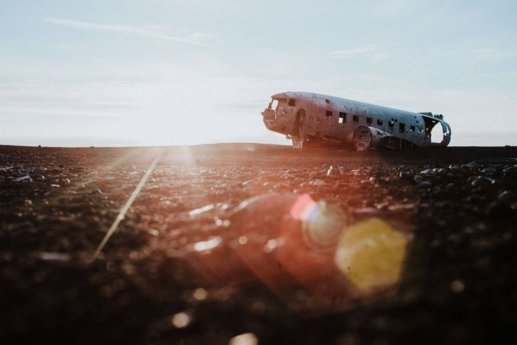 Abandoned Airplane On Field Against Sky During Sunny Day