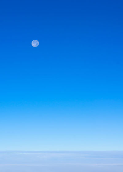 Scenic view of moon against clear blue sky