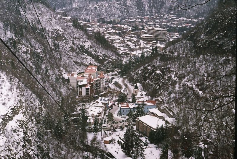 Architecture Borjomi Building Exterior Built_Structure Cold Temperature Day Film Film Photography Georgia High Angle View House Landscape Mountain Nature No People Outdoors Snow Travel Tree Village Winter The Great Outdoors - 2017 EyeEm Awards Let's Go. Together. Shades Of Winter
