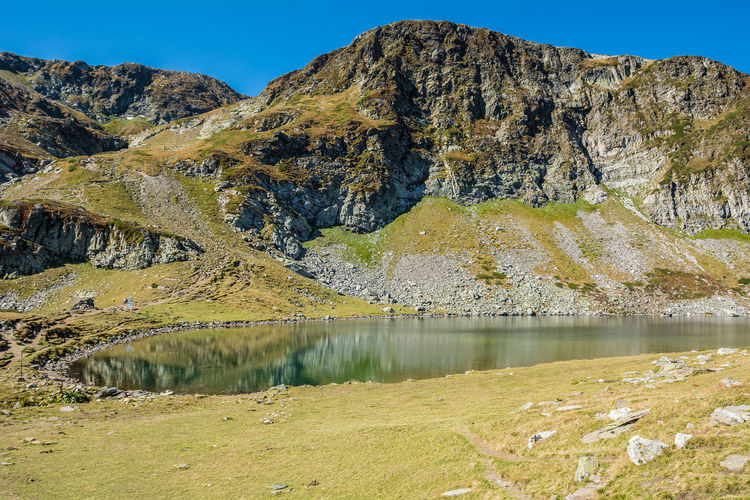 Seven Rila lakes, Bulgaria; The Kidney Бъбрека (Babreka) 2,282 m (7,487 ft) 8.5 ha (21 acres) 28.0 m (91.9 ft) Water Mountain Beauty In Nature Lake Tranquil Scene Scenics - Nature Tranquility No People Non-urban Scene Nature Mountain Range Day Reflection Idyllic Sky Rock Landscape Remote Rock - Object Outdoors Formation Mountain Peak Nature Photography Nature Stone
