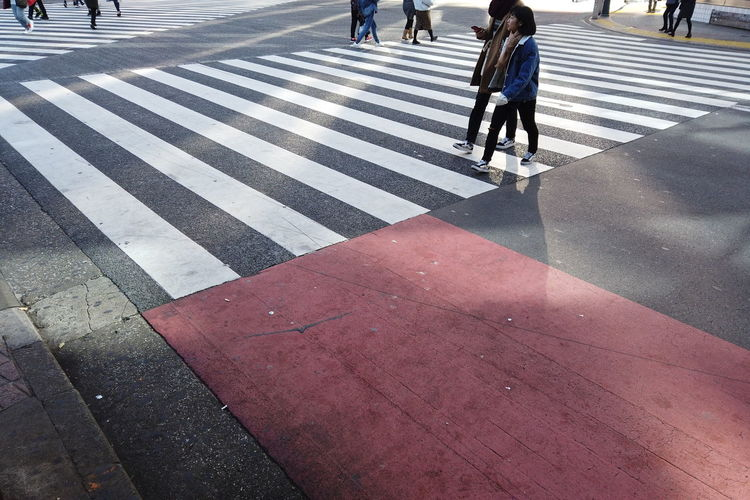 Morning Morning Light People Urban Walking Japan Shibuya Shibuya Crossing Intersection Business Finance And Industry Business Walking Around City Cityscape Street Tokyo Crosswalk Crossing Road Marking Zebra Crossing Road Sign Transportation Day Marking Real People City Life Women Symbol Group Of People Striped Architecture Incidental People Outdoors City Street
